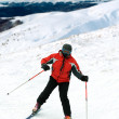 Skier man in snow-covered mountains — 图库照片