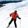 Foto Stock: Skier man in snow-covered mountains