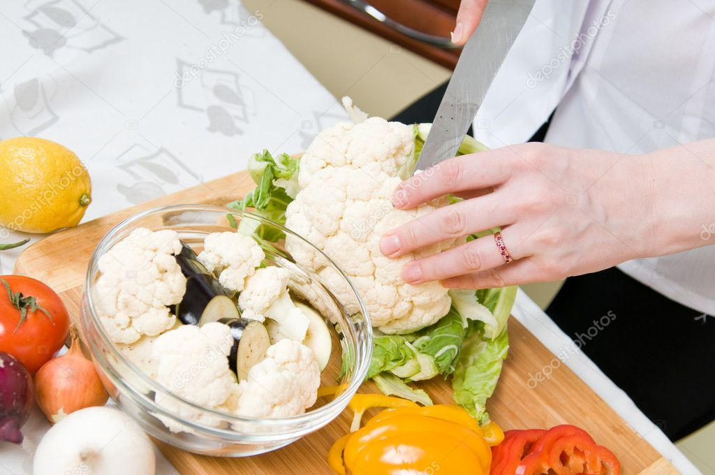 Preparation of vegetarian salad from fresh vegetables  Stock Photo #5354124