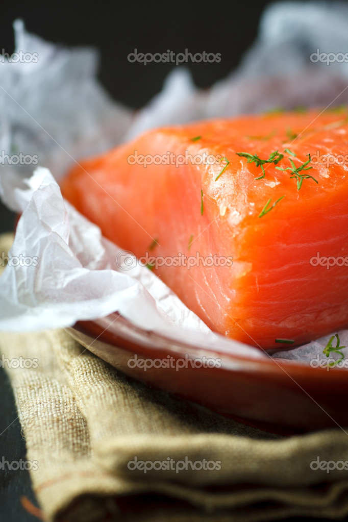 Piece of smoked salmon with dill on the plate,shallow focus — Stock Photo #3936740