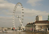 London view with the Millenium Wheel and river Thames.We — Stock Photo