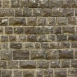 Black Basalt stone wall background — Stockfoto