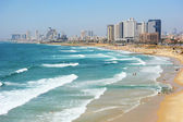 Sea coast and the view of Tel Aviv at the evening — Stock Photo