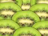 Abstract green background with raw kiwi slices — Stock Photo