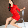 Girl sits on a chair — Stockfoto