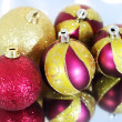 Five Christmas balls on a blue background — Stock Photo #4063950