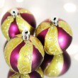 Three red Christmas ball on a background of lights — Stock Photo