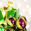 Stock Photo: Three red Christmas balls and gift box