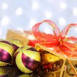Stock Photo: Christmas balls and gift box on the background lights