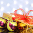 Christmas balls and gift box on the background lights — Stock Photo