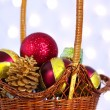 Christmas toys in a wicker basket — Stock Photo
