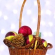 Christmas toys in a wicker basket - Stockfoto