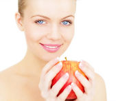 Beautiful girl holding a red apple isolated on white background — Stock Photo