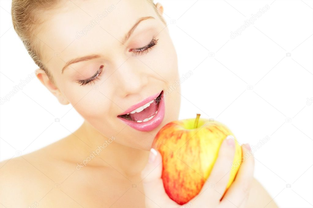 Attractive girl eats an apple isolated on white background — Stock Photo #4191436