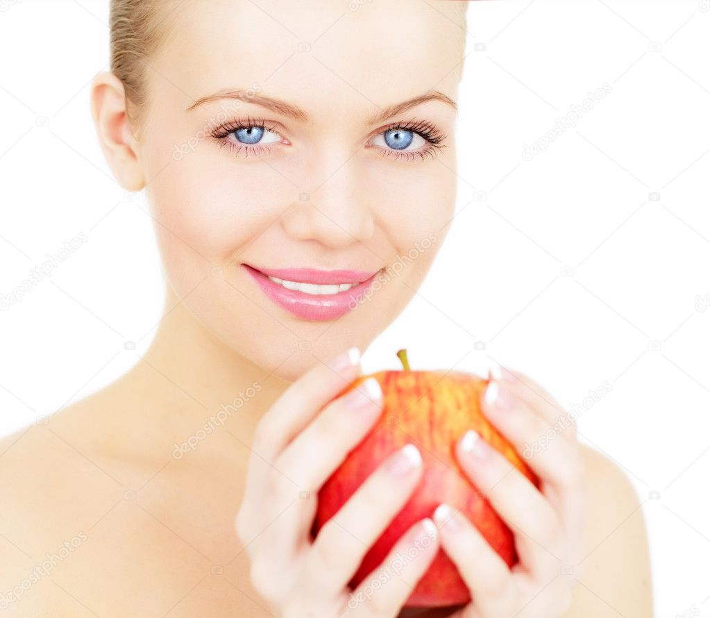 Beautiful girl holding a red apple isolated on white background — Stock Photo #4191464