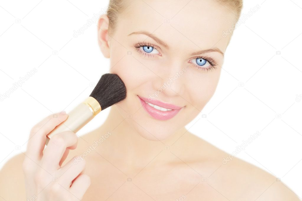 Young woman applying blusher isolated on a white background — Stock Photo #4234150