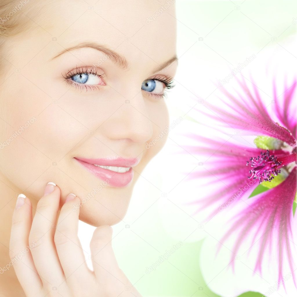 Girl's face and a flower — Stock Photo #4282677