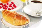 Breakfast. A cup of coffee, croissant and berries — Stock Photo