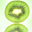 Kiwi closeup on green background - Stock Photo