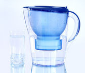 Water filter on a light blue background — Stock Photo