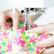 Fabric in a sewing machine — Stock Photo