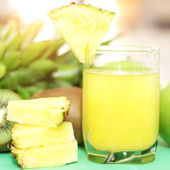 Pineapple juice on a light background — Стоковое фото