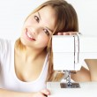 Girl with sewing machine on light background — Stock Photo