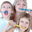 Family cleaning teeth - Stock Photo