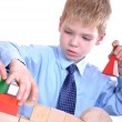 Schoolboy playing with bricks — Foto de Stock