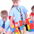 Children playing with bricks — Stock Photo #4207740