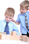 Boys playing with bricks — Stock Photo