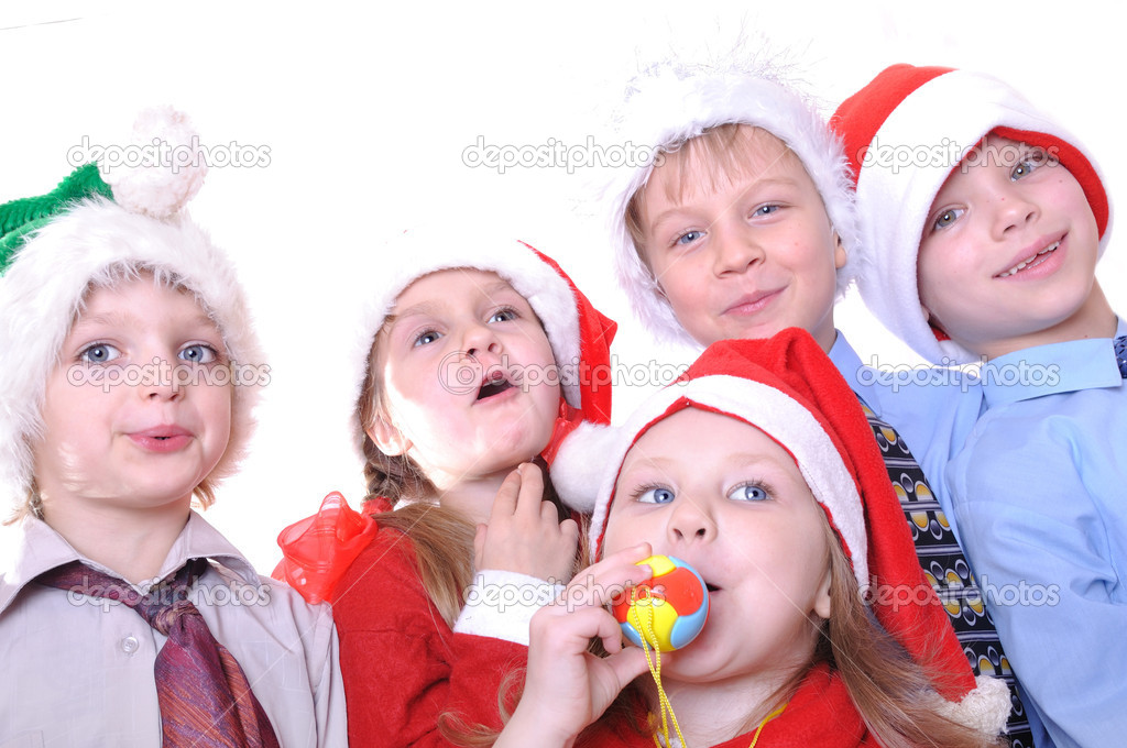 Group of happy kids with Santa hats — Stock Photo #4247622