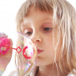 Child blowing bubbles — Stock Photo #4443197