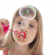 Child blowing bubbles — Stock Photo #4596592
