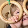 Child playing at gymnastic rings — Stock Photo