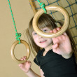 Royalty-Free Stock Photo: Child playing at gymnastic rings