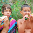 Stock Photo: Kids having dinner outdoor