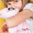 Child with a toy cat — Stock Photo