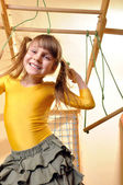 Child at her home sports equipment — Stock Photo