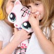 Children with a toy plush cat — Stock Photo