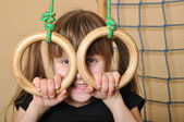 Child with gymnastic rings — Stock Photo