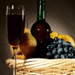 Still life with red wine and fruits — Stock Photo