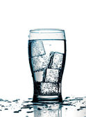 Glass with cold purified water and ice — Stock Photo