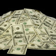 Stock Photo: Big pile of money. dollars over white background