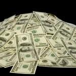 Big pile of money. dollars over white background — Stock Photo