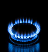 Blue gas stove in the dark — Stock Photo