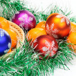 Mandarin,pine branches and christmas balls — Stock Photo