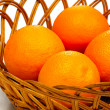 Basket of oranges on white background - Stock Photo