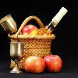 Apples,wine glass and bottle in the basket on a black  backgroun - Stock Photo