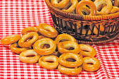 Basket with bread ring on a motley background — Stock Photo